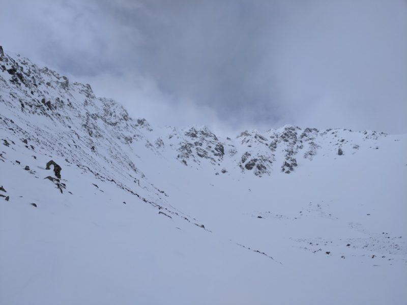 Basin below Saviers Peak showing a thin snowpack and lots of wind scouring.